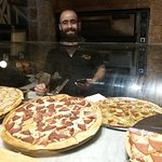 George the happy pizza maker at Jacob's Pizza near the Jaffa Gate