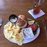 Crabcake sandwich, coleslaw, kettle chips at Fager's Island Restaurant, Ocean City, Md