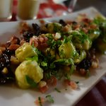 Artichokes Sauteed with Iberian Ham, Raisins, and Pine Nuts