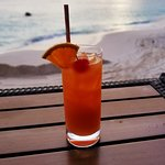 A rum swizzle at the bar at the beach.