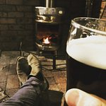 Relax & enjoy a beer by our fireplace