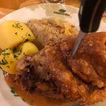 Interior restaurant and popular pork knuckle meal