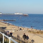 Walking along the path towards Southwold Pier