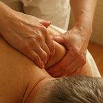 man gets shoulders massaged