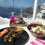 Seafood appetizers and Greek salad with a view