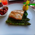 Pan seared mahi with spinach and asparagus.