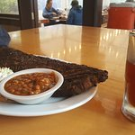Ribs and a mug of beer. Beer also comes in pints.