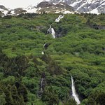 Waterfalls goes from the top of the glacier to the bottom