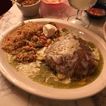 Stacked enchiladas with charro beans, green chile rice, Mexican salad, sour cream and a house Ri