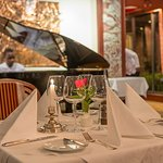 Enjoy regional and international specialties as well as live piano music