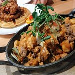 BBQ brisket hash with chicken + waffles in the background. SO DELISH!