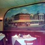 a wall mural depicting an Italian neighborhood in Chicago