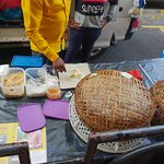 A delicious sweet rice noodle snack made with coconut and sugar, during the market visit