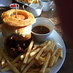 Chicken burger with onion ring chips and dipping gravy.