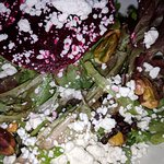 Close up of special salad featuring roasted pistachios, beets, goat cheese!