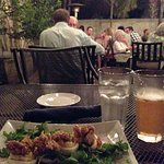 Patio dining w/ deviled eggs (on a bed of arugula & tomato chutney topped with fried oysters)  & cider.