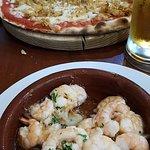 Chicken pizza and garlic king prawns.