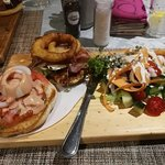 Chicken burger with bacon and brie and salad. Tasty