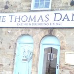The Thomas Daniell pub Truro.  Bus stops on both sides of the road, just outside.