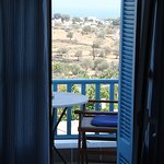 view through shuttered doors to balcony and beyond - in the heart of sifnos