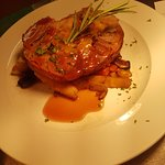 Lamb Shoulder with apricot & sage stuffing on a bed of root veg
