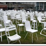Photo of 185 Empty White Chairs - Earthquake Memorial