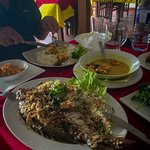 Grilled whole Grey Mullet (local name), Sri Lankan rice, coconut symbol and prawn curry and rice.