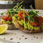 Avo toast - multigrain sourdough, smashed avocado, local tomatoes, local pea shoots, lime and chillies