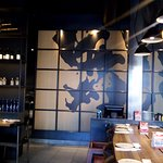 EAST IZAKAYA interior.  Features Japanese influence and live edge tables.