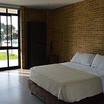 Cómodas habitaciones con baño privado, ideal para parejas,grupos familiares o empresariales.