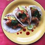 Battered Shrimp Taco w/ sliced avo, mango salsa, pickled Cabbage & spicy aioli