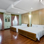 Best place for family trip in center of Danang include 2 king beds, a private bath -tube bathroom. The maximum number of extra beds in a room is 1. Come with a terrace and others also feature city views.