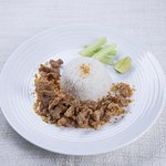Stir-fried pork with garlic served with steamed rice