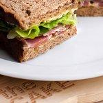 Sandwich with fresh tuna, pickles, mustard in rye bread