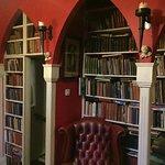 Room to relax with secret hidden door in the bookcase to basement room.