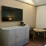 Dresser offers ample space, houses mini bar and in-room Nespresso including pods, cream and sweetener.