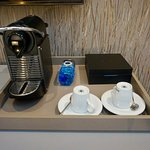 Close up of the in-room coffee service, restocked daily including bottled water