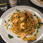 Homemade tagliolini with fresh prawns and wild mushrooms