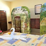 """Inside of beachfront bungalow """"ChacChoben"""". With private roof terrace and view over the ocean. Perfect room for a couple with one queen size bed"""