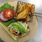 Chicen avocado sandwich served with homemade mesquite kettle chips