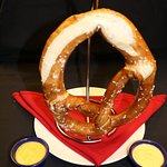 Fresh baked pretzel served with cheese sauce
