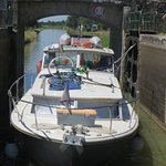 Four days afloat on our cabin cruiser; comfortable, friendly and easy to handle. Entering into a lock on the canal between Decize and Cercy-La-Tour.