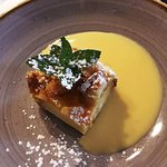 Festive menu Brioche bread & butter pudding with an apricot glaze and vanilla custard.