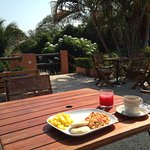 Breakfast alongside the pool, with a distant view on the ocean <3