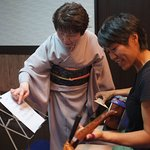 My friend getting taught how to play the shamisen.