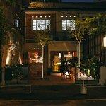 Lucky Tora's facade at night