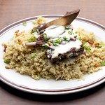 the Mansaf, authentic Jordanian dish, bone-in lamb in yougert sauce.