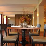 Two Henrys serves seasonal menus for breakfast, lunch, and dinner overlooking the hotel's back l