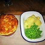 Chicken pie & mash with peas served in a metal camping dish for £13.90.  Looks fine but check out my picture of what's inside the pie - chicken soup!