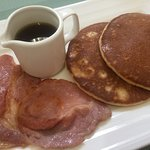 From the hot breakfast menu; Pancakes with Canadian maple syrup and bacon.